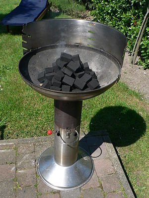 Regional variations of barbecue - Briquettes placed in a barbecue cooker