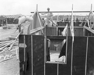 Manzanar - Barracks under construction at Poston. Barrack construction and materials were the same at all ten camps, including Manzanar. Poston, Arizona May 5, 1942