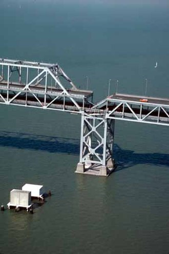 Eastern span replacement of the San Francisco–Oakland Bay Bridge - Collapsed section of roadbed visible above support tower immediately after the Loma Prieta earthquake in 1989