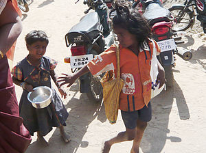 English: Child beggers begging infront of a ch...