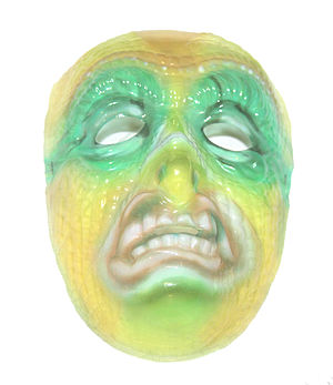 Ben Cooper, Inc. - A translucent Halloween mummy mask sold by Ben Cooper, Inc. in the 1960s.