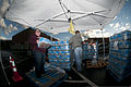 Bethany Whisman and Blake Kenney, both of Poca, W.Va., hand out cases of bottled water at Poca High School Jan. 11, 2014, to those affected by the Elk River water contamination 140111-Z-LQ742-016.jpg