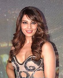 Bipasha Basu is looking towards the camera.