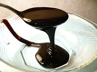 Molasses viscous by-product of the refining of sugarcane, grapes, or sugar beets into sugar