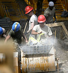 Bond beam work at Gabriela Mistral School construction site 150622-F-LP903-959.jpg