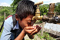 Boy drinks from a tap at a NEWAH WASH water project in Puware Shikhar, Udayapur District, Nepal. (10677903803).jpg