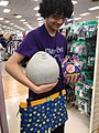 Boy holding assorted items at a marshalls.jpg