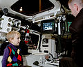 Boy tours a Stryker, note remote control for Remote Weapons Station.jpg
