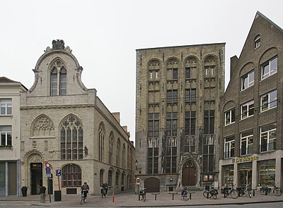 "The term bourse is derived from the 13th-century inn named ""Huis ter Beurze"" (center) in Bruges. From predominantly Dutch-speaking cities of the Low Countries (like Bruges and Antwerpt), the term 'beurs' spread to other European states where it was corrupted into 'bourse', 'borsa', 'bolsa', 'borse', etc. Brugge - Saaihalle en beurs.jpg"