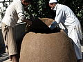 Building an oven out of mud in Afghanistan.jpg