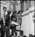 Byron, California. The moment has come for these farm families of Japanese descent to board the bus . . . - NARA - 537465.tif