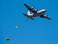 C-130 dropping paratroopers over Elmendorf (7674385430).jpg