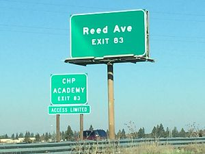 California State Route 84 - The I-80 East bound freeway signage indicating the California State Route 84 (unsigned) Eastern terminus at the Reed Ave interchange in West Sacramento