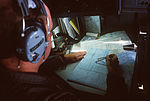 Capt. Donald E. Link, navigator, plots the course for an Sentry Airborne Warning and Control System (AWACS) aircraft during a tactical large force employment exercise DF-ST-84-09462.jpg
