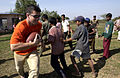 Captain Jeffery Mohr teaches an Indian boy how to play American football at an orphanage in Gwalior.JPG