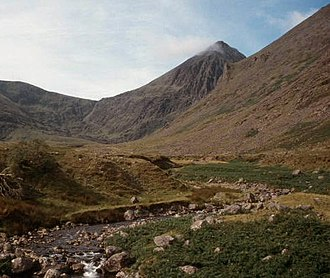 Carrauntoohil - Carrauntoohil (r) from Hag's Glen, with the Devil's Ladder path to the col between Carrauntoohil (r) and Cnoc na Toinne (l) visible in the distance