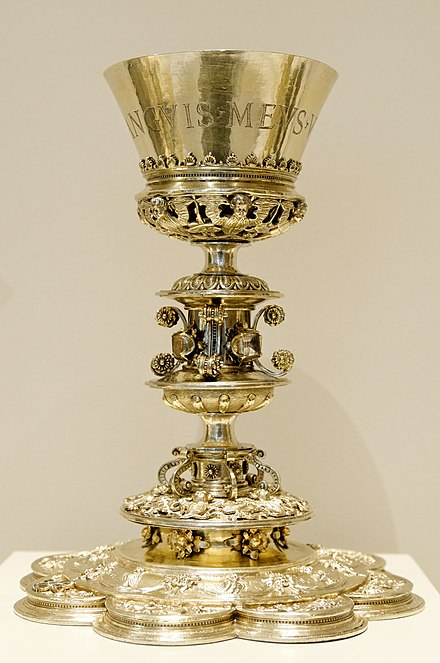 "Chalice with the inscription: ""Sanguinis meus vere est potus"" (i.e. 'My blood is drink indeed' (John 6:55, KJV)), made for the church St John the Baptist in Salinas, Spain. Chalice Burgos VandA 132-1873.jpg"