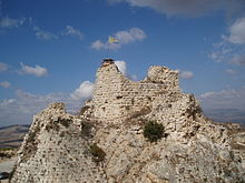 rugged rocky peak with stones and the remains of a tower