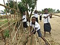 Children building the fence of their school.jpg