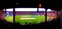 Fans cheering during an IPL match