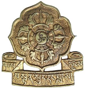 "Chushi Gangdruk - Badge of the ""Tibetan Volunteer Defenders of the Faith"". Inscription in Tibetan is gangs ljongs bstan srung dang blangs."