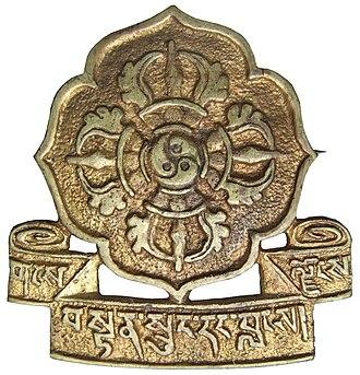 "Chushi Gangdruk - Badge of the ""Tibetan Volunteer Defenders of the Faith"". Inscription in Tibetan is gangs ljongs bstan srung dang blangs."