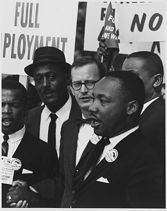 Catholic laity - Mathew Ahmann, Catholic layman and speaker during the March on Washington, behind Martin Luther King, Jr.