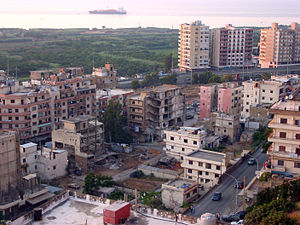 Bab al-Tabbaneh–Jabal Mohsen conflict - Buildings in Bab al-Tabbaneh damaged during the Lebanese Civil War, Syria Street which divides the two neighbourhoods can be seen in the lower right