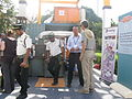 Climate Foundation team and pieces of the pyrolysis reactor on display - and Indian security guards (13359294153).jpg