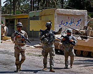 Operation Marne Torch - Coalition Soldiers patrol a street in Arab Jabour during Marne Torch I