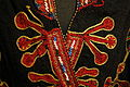 Coat, Mangal Pashtun people, Afghanistan, view 2, early to mid 20th century, wool, cotton, silk, metal thread, glass and plastic beads - Textile Museum of Canada - DSC00923.JPG