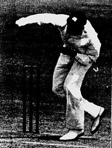 A cricketer bowling.