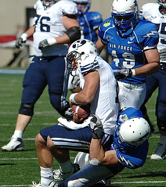 Quarterback sack - A BYU quarterback being sacked by Air Force.