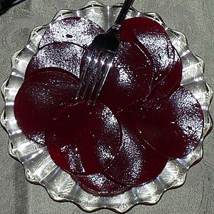 Cranberry sauce from a can, sliced.