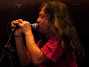 former Can singer Damo Suzuki performing live ...