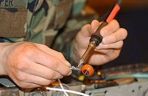 (De)soldering a contact from a wire.