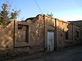 Destroyed house in arg ave Nishapur.JPG