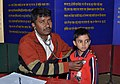 Doctor examining a child in a medical camp, organised by the DFP, during the Bharat Nirman Public Information Campaign, at Hilli Block, Dakshin Dinajpur, West Bengal on February 06, 2012.jpg