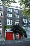 foto van Pakhuis, zijvleugel van het pakhuis lange ijzerenbrugstraat 10, met lijstgevel