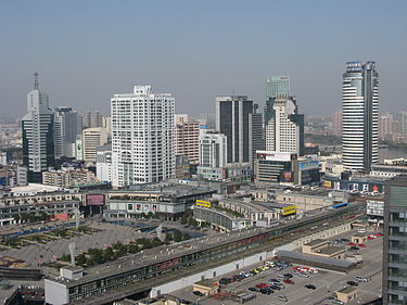 The bustling downtown of Ningbo City with the nationwide famous shopping complex Tianyi Square, named after the Tianyi Ge (Chamber), the oldest private library in China. Downtown Ningbo with Tianyi Square.jpg