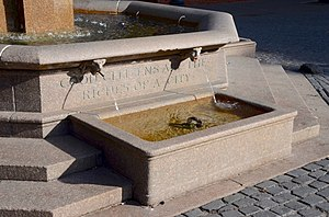 "Skidmore Fountain - Horse trough on northwest side of the fountain, with the inscription ""Good citizens are the riches of a city"" above"