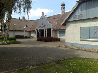 Part of the former Autotron museum in Drunen (later located in Rosmalen), with the typical Anton Pieck colors Drunen - Voorste Venne (1).jpg
