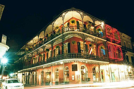 Elaborate ironwork galleries on the corner of Royal and St. Peter streets New Orleans