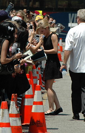 Emma Watson signing autographs for fans outsid...