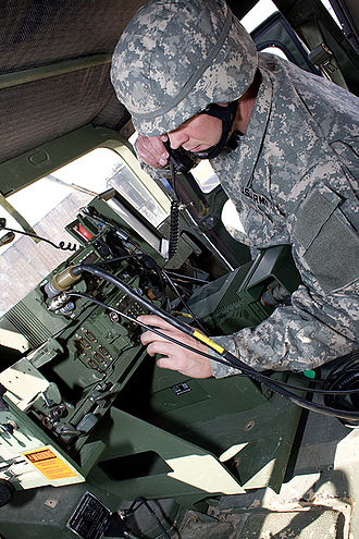 SINCGARS - A SINCGARS is being operated from within a HMMWV