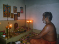 Ezhuthachan(Kadupattan) worshipping his deity.png