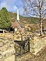 Fåvang Church (kirke) c. 1630, at Tromsnesvegen, Fåvang, Ringebu, Gudbrandsdalen, Oppland, Norway. Graveyard (kirkegård), gate, springtime, stone fence, Korstadkampen, etc. 2017-04-05 4054.jpg