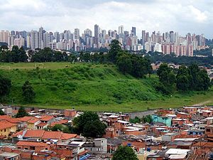 Wealth inequality in Latin America - Slums on the outskirts of a wealthy urban area in São Paulo, Brazil is an example of inequality common in Latin America.