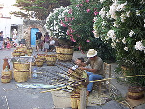 Cabanes, Girona - Making wickerware in main square of Cabanes