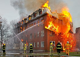 firefighters at a major fire involving an abandoned convent in canada 2006